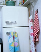 An old fridge and tea towels