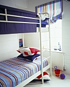 A white metal bunk bed in a children's bedroom