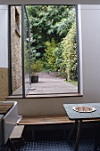Kitchen with open terrace door looking onto a garden