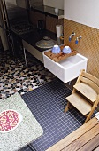 A range of tiling styles on a floor in a kitchen