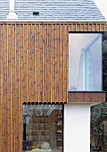Vertical wood panelling on a newly built house with floor-to-ceiling windows