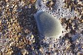 Stone in foaming water