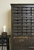 An antique drawer unit