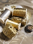 Spools of gold and silver yarn and thread