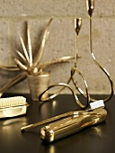 Various golden bath utensils (toothbrush, nail brush, etc)
