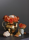 A bunch of roses in a Moroccan teapot