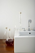Decorative measuring jugs and glasses next to a sink