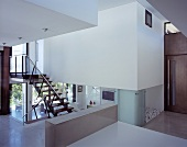 Open-plan living in a newly built house with various levels and open staircases