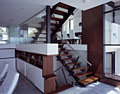An open stairwell with a view of a dining area in a modern, newly built house