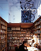 A study corner in an open room with a view of a gallery and parked bicycles