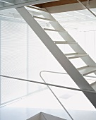 Detail of a white-painted metal ladder
