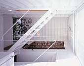 A newly built house with an open stairway and a view into various rooms