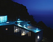 A newly built house on a hillside with a sea view in the evening - House Izu, Tokyo, Japan
