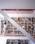 An open stairway with built in bookshelves