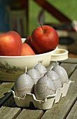 Egg-shaped candles and apples