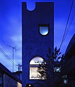 Modern architecture - a tree in front of The Tower House, Tokyo, Japan in the evening