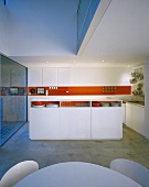An open-plan, designer kitchen in red and white