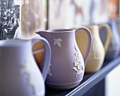 A collection of pastel-coloured ceramic jugs