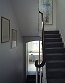 A simple stairwell with a carpet runner