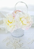 White peonies and a pearl necklace