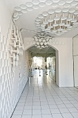 An entrance area with white floor tiles and porcelain wall decoration in the Rosenthal Casino, Selb