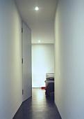 A view along a corridor into a bedroom