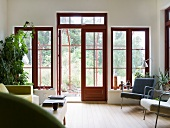 A living room with terrace doors