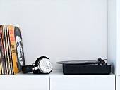 A record player with records and headphones