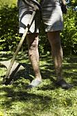 A man mowing grass