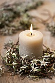 A candle in a willow wreath with edelweiss