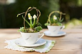 Spring table decoration in a porcelain cups