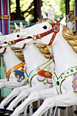 An old fashioned children's carousel with horses