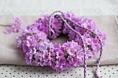 A wreath of purple baby primroses