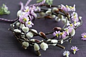 A wreath of willow catkins and baby primroses