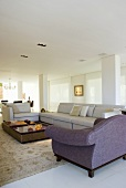 An elegant living room with seats and a coffee table