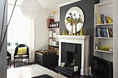 A black fireplace with a white mantelpiece and a bookshelf in a living room