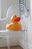 A giant rubber duck on a Philippe Starck chair