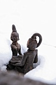 An oriental garden ornament in the snow
