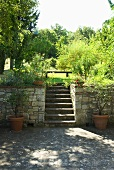 Steps leading from a terrace to a garden