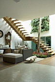 A sitting area with a flight of stairs and Dedon furniture