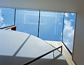 View of the sky through the glass roof of a staircase