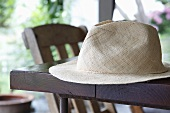 A summer hat on a table