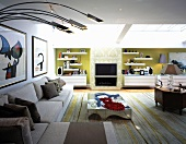 A modern corner sofa and arched stainless steel lamps in a spacious living room
