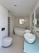 Designer bath with curved bathroom fittings