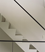 Section of a stairway with minimalist stainless steel handrail