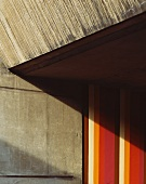 Detail of the concrete facade of a house and colorful stripes