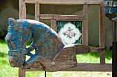 Wooden horse on a garden bench