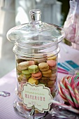 Colorful macaroons in a glass jar