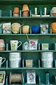 Green wooden shelves with garden implements