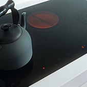 A kettle on a glass hob
